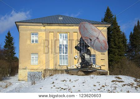 ST. PETERSBURG, RUSSIA - FEBRUARY 17, 2016: Small radio telescope at the building of the special astrophysical Observatory of the Russian Academy of Sciences. Pulkovo Observatory