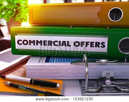 Green Ring Binder with Inscription Commercial Offers on Background of Working Table with Office Supplies and Laptop. Commercial Offers Business Concept on Blurred Background. 3D Render.