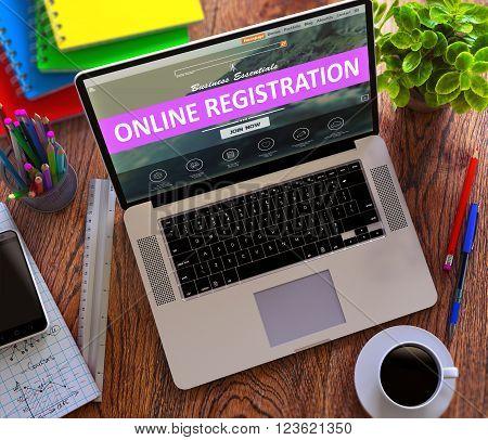 Online Registration Concept. Modern Laptop and Different Office Supply on Wooden Desktop background. 3D Render.