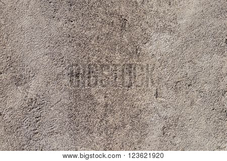 Texture of rough unpainted plaster wall background