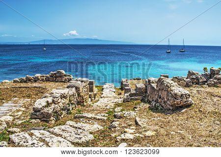 some boats by Tharros coastline in Sardinia