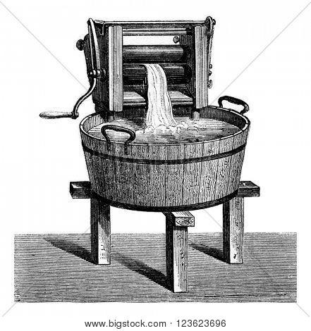 Wringer, vintage engraved illustration. Magasin Pittoresque 1873.