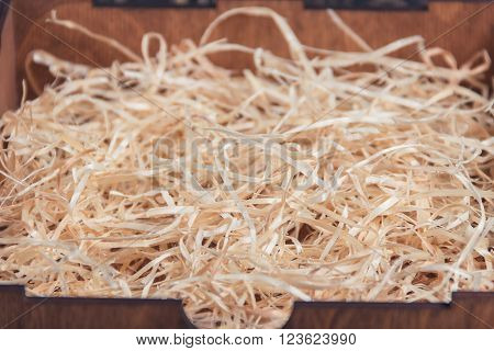 background of the golden curls of a wood shavings