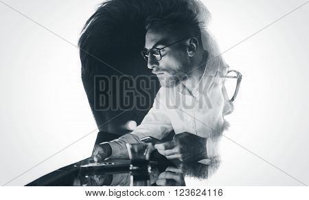 Portrait of stylish bearded lawyer wearing glasses and looking city. Double exposure, businessman working at night, texting smartphone background. Isolated white.