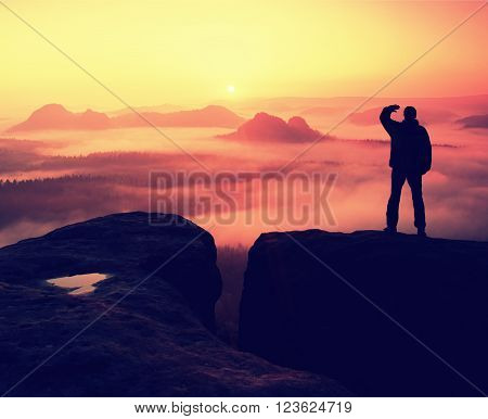 Happy Hiker Is Standing On The Peak Of  Rock Empires Park And Watching Over The Misty And Foggy Morn