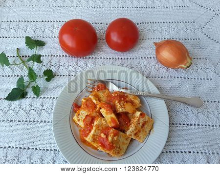 Tofu tomato onion melissa on a plate with Melissa cooking healthy  food for a vegetarian diet