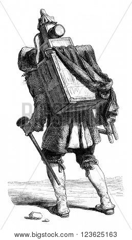 The Man with the magic lantern, 1774, vintage engraved illustration. Magasin Pittoresque 1870.