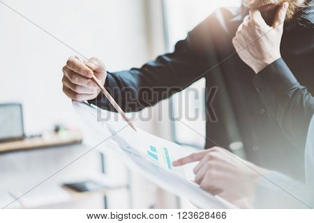 Team job process. Closeup photo young business managers  working with new startup project in modern office.Analyze document, plans. Holding papers, documents, pencil hands. Horizontal