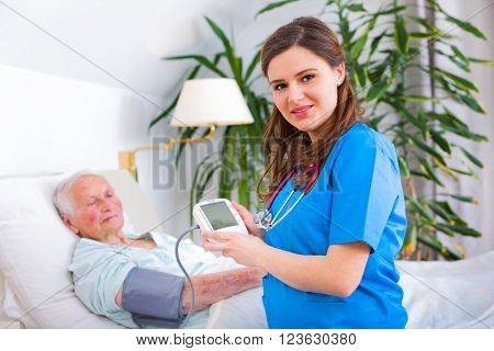 Loving Caregiver Measuring Blood Pressure