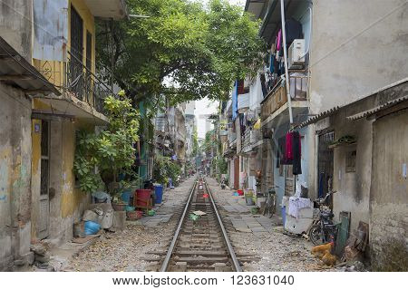 HANOI, VIETNAM - DECEMBER 14, 2015: Cloudy day on the outskirts of Hanoi. Dwelling houses and Railway passes through the streets of Hanoi