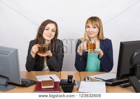 Tea Break Two Office Employees At The Desk