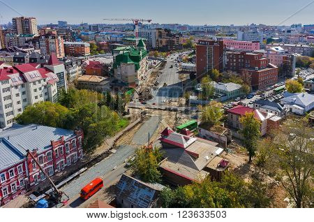Tyumen, Russia - September 17, 2015: Aerial view of road construction on Pervomayskaya street