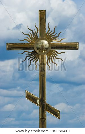 Cross at the dome of a church at St. Nil Monastery on Seliger Lake, Russia