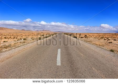 Arid empty desert road in the Middle Atlas Mountains in Morocco Africa