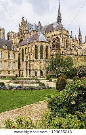 Reims, France - May 15: There is backside of the Reims Cathedral and garden of the Archbishop of Reims May 15, 2013 in Reims, France.