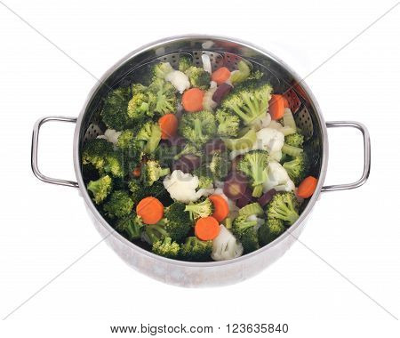 Steam cooked vegetables on stainless steel steamer