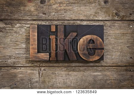 like, word set with antique letterpress type on rustic wooden background