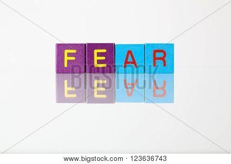 Fear - an inscription from children's wooden blocks