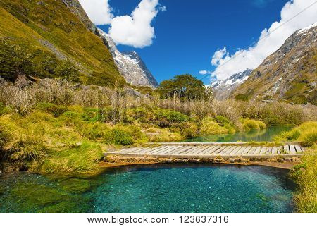 Gertrude Saddle with a snowy mountains and turquoise creek, Fiordland national park, New Zealand South island