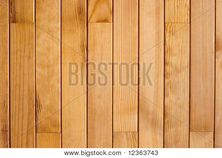 The wall decorated by varnished wooden  planks background pattern