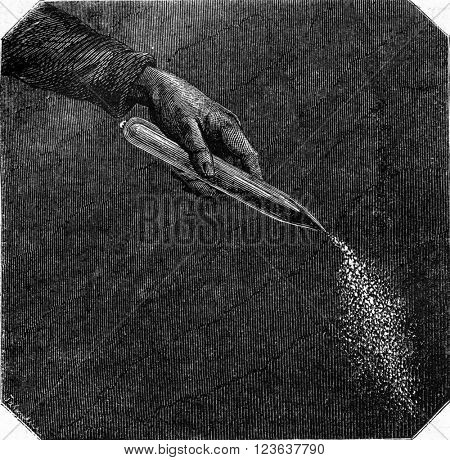 Combustion of pyrophoric iron, vintage engraved illustration. Magasin Pittoresque 1869.