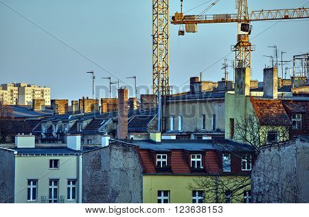 Roofs of houses chimneys antennas and cranes in Poznan ** Note: Soft Focus at 100%, best at smaller sizes