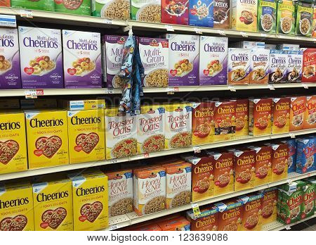 RIVER FALLS,WISCONSIN-MARCH 28,2016: Several different varieties of Cheerios cereal and other breakfast items.