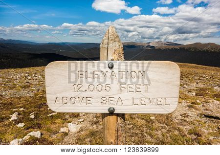 A wooden, elevation above sea level sign in Rocky Mountain National Park, Colorado