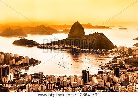 Rio de Janeiro, Brazil. Suggar Loaf and  Botafogo beach viewed from Corcovado at sunset. Rio de Janeiro is the 2016 summer olympic games hosting city.