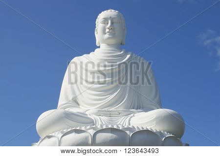 Giant sculpture white Buddha, pagoda in Long Sean closeup. Nha Trang, Vietnam