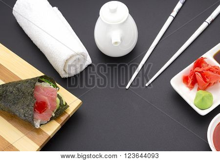 Tuna Sashimi On A Wooden Plate With Ginger Wasabi Sauces Over Black Background