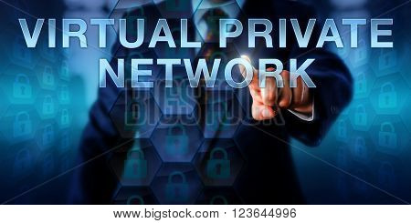 Enterprise user is touching VIRTUAL PRIVATE NETWORK on a screen. Information technology concept and business model metaphor for a private computing network utilizing a public computer network.