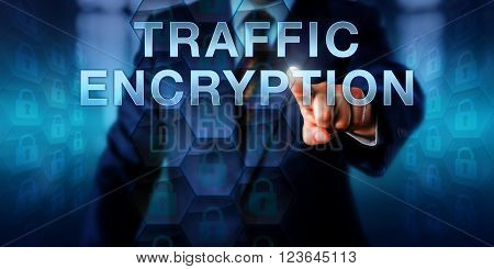Corporate user pushing TRAFFIC ENCRYPTION on a touch screen interface. Information technology and internet security concept for encoding transmitted messages and data for authorized recipients only.