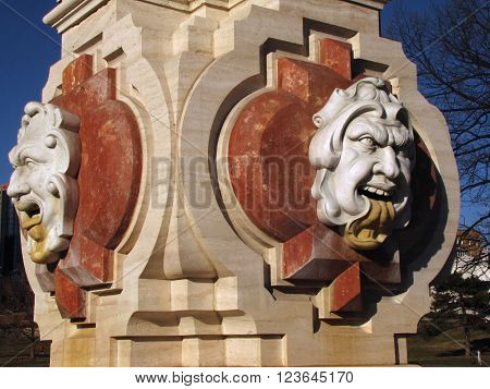 Two emotional faces on the Seville Light Fountain on The Plaza in Kansas City, MO