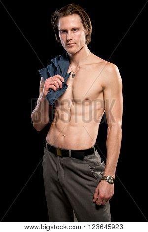 Attractive man shirtless. Studio shot over black.