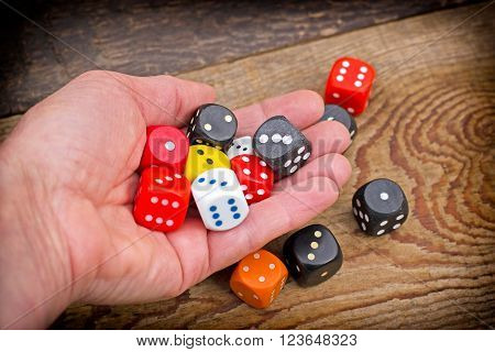 Hand throws dice on table - Gambling addiction