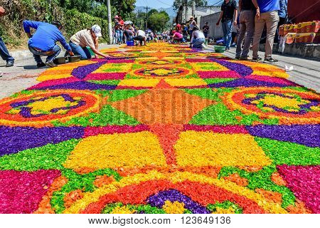 Antigua Guatemala - March 24 2016: Locals make dyed sawdust Holy Thursday carpets in street for procession in colonial town with most famous Holy Week celebrations in Latin America.