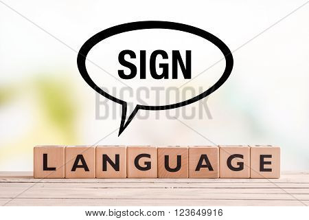 Braille language lesson sign made of cubes on a table