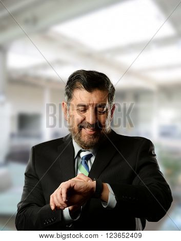 Mature Hispanic businessman inside an office building