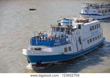 LONDON, UK - SEPTEMBER 10, 2015: Tourist's boat on the River Thames in sunny day