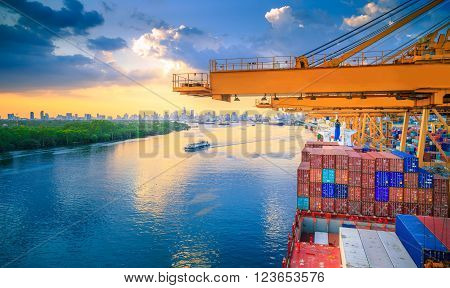 Import Cargo River Side And Containers On Top Of Shipyard At Sunset View