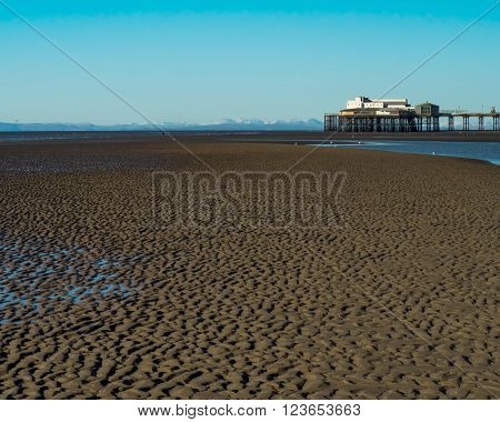 North pier BlackpoolUK with Cumbrian hills in snow