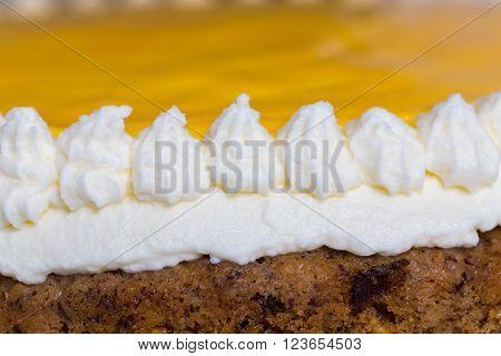Advocaat cake on white wood macro. background