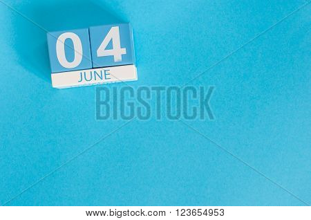 June 4th. Image of june 4 wooden color calendar on blue background.  Summer day, empty space for text.
