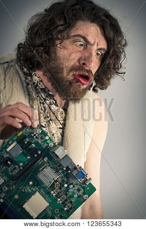Silly grunting caveman confused by modern computer technology
