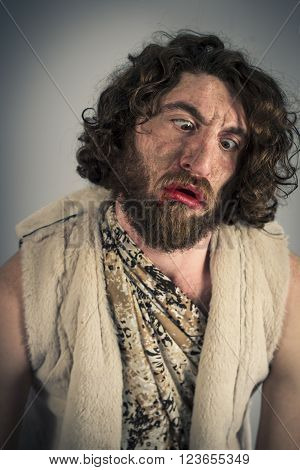 Silly realistic caveman with dirty face and crossed eyes