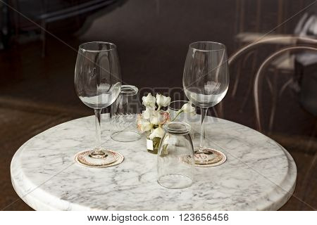 Two wine glasses in romantic restaurant dinner setting
