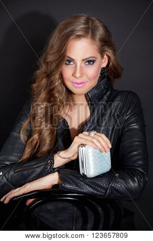 Pretty woman holding an extravagant party clutch
