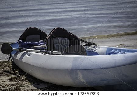 Kayak - Single kayak pulled up onto a beach