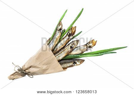 Smoked capelin with green onions in paper cornet on white background. Top view